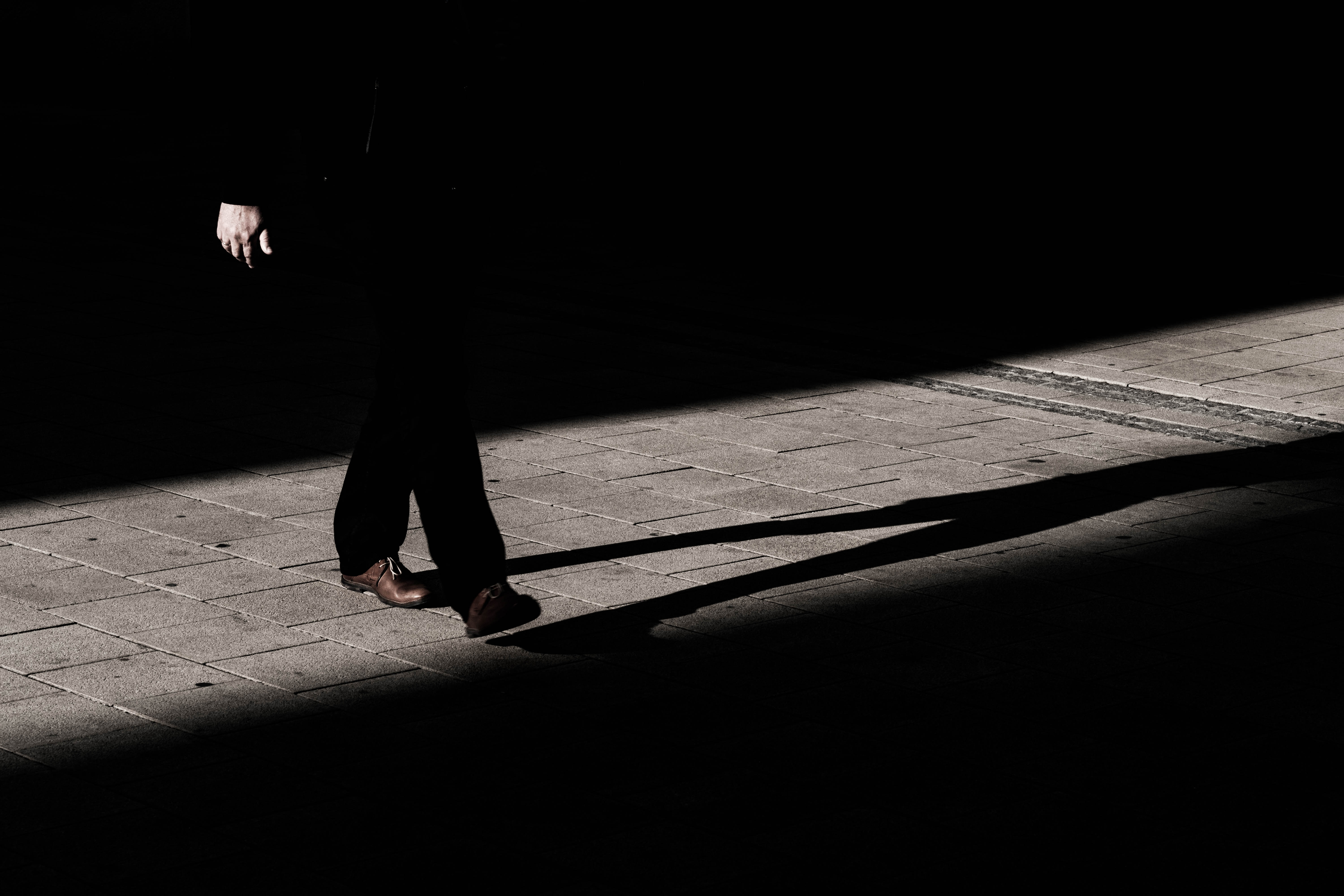 Man walking in the shadow