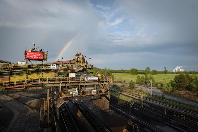 Ende Gelände -- occupied machine and rainbow